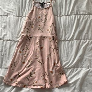 light pink dress with daisy print
